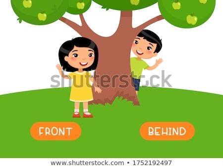 Petite fille derrière arbre sourire forêt jardin Photo stock © photography33