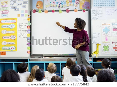 teacher pointing at white board stock photo © photography33