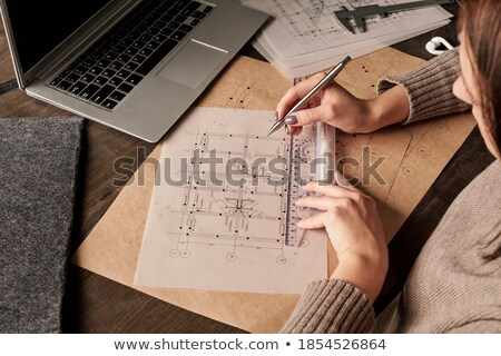young female architect writing with pen stock photo © candyboxphoto