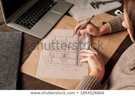 Young Female Architect Writing With Pen Stock photo © Pressmaster
