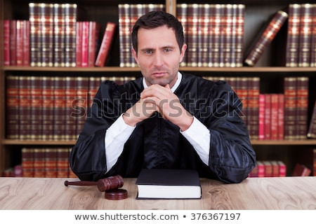 Serious male judge thinking Stock photo © broker