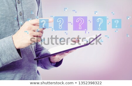 Businessman holding digital tablet with question Stock photo © filmcrew
