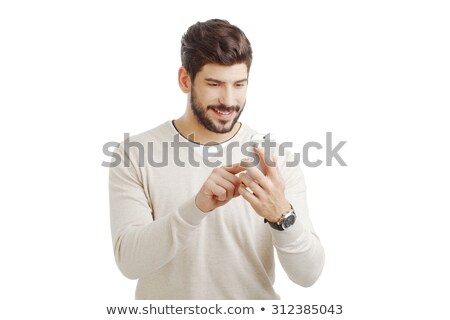 Businessman writing text message against a white background Stock photo © wavebreak_media