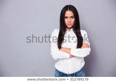 Angry looking brunette beauty. Stock photo © lithian