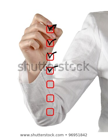 Stock photo: Young woman business hand with pen mark the check boxes. Hands o