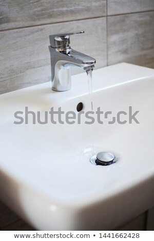 metal sink with flowing water Stock photo © Grazvydas