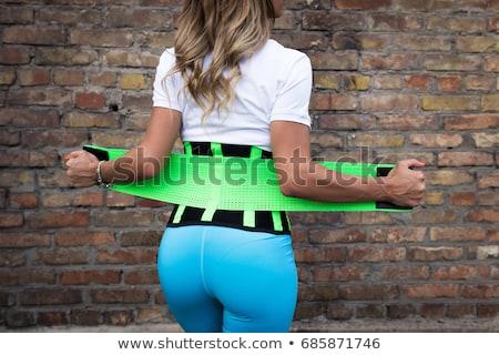 Vrouw korset silhouet achtergrondverlichting foto sexy vrouw Stockfoto © dolgachov