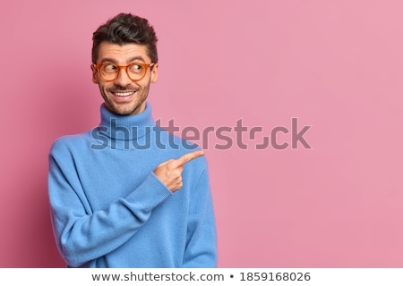 young man is showing something stock photo © filipw