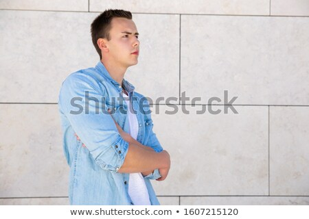 casual man outdoor looks away frowned Stock photo © feedough
