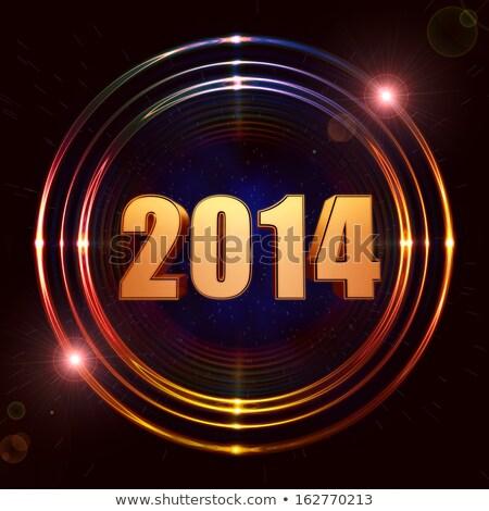 new year 2014 in shining golden rings Stock photo © marinini