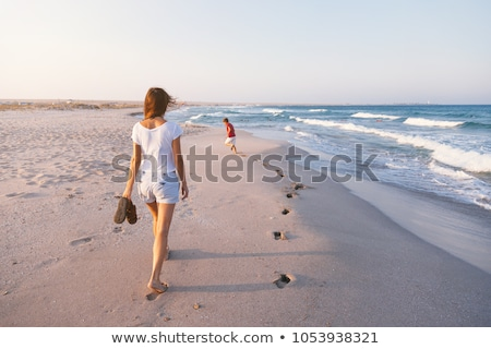 Fiú reggel tengerpart aranyos tenger szépség Stock fotó © meinzahn