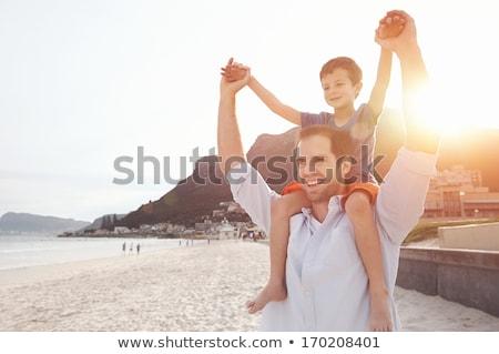 幸せ 子供 演奏 ピギーバック ビーチ 夏 ストックフォト © monkey_business