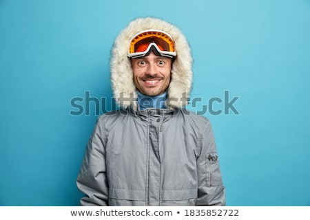 Man Standing In Snow Wearing Warm Clothes On Ski Holiday In Moun Stock photo © monkey_business