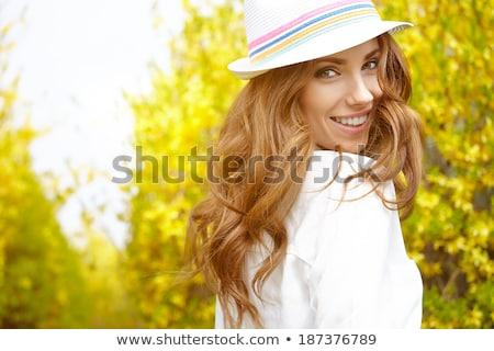 Kadın sarı çiçek güzel genç bayan Stok fotoğraf © fouroaks