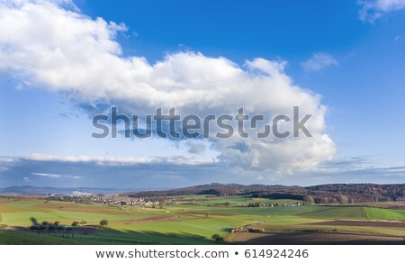 landscape with acre and blue sky at ronneburg hesse stock photo © meinzahn