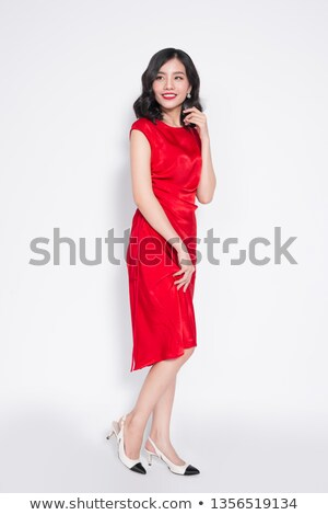 élégant jeunes femme rouge permanent main Photo stock © smithore