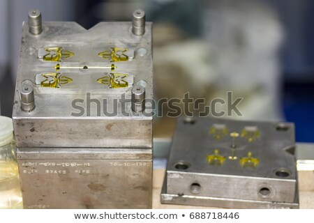Mass production of plastic parts Stock photo © pixpack