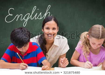 Mooie leraar helpen leerlingen bibliotheek Stockfoto © wavebreak_media