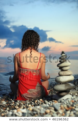 beautiful woman in red sundress sitting near to pyramid from peb Stock photo © Paha_L