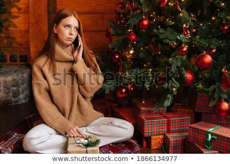 woman talking on the mobile phone on christmas eve stock photo © stevanovicigor