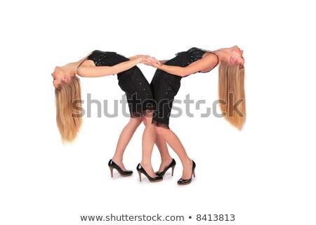 Twin girls bend behind Stock photo © Paha_L