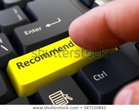 Finger Presses Yellow Keyboard Button Recommend. Stock photo © tashatuvango