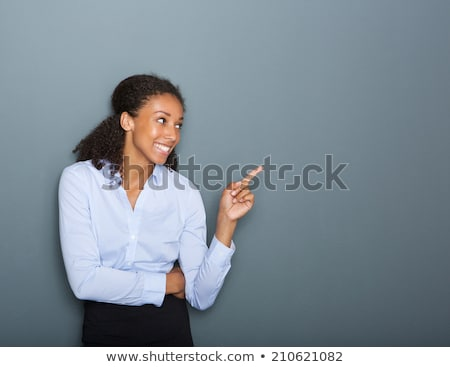 Thinking business woman smiling and looking up at copy space Stock photo © deandrobot