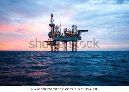 Fúrótorony olajkút éjszaka világítás kint építkezés Stock fotó © justinb