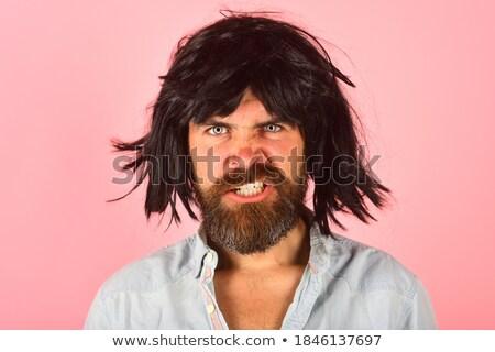 Profilo arrabbiato pazza barbuto giovane piedi Foto d'archivio © deandrobot