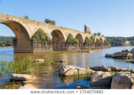 Old bridge of Ajuda in Guadiana river. Stock photo © inaquim