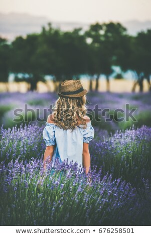 Back view of Woman Surrounded by plants Stock photo © deandrobot