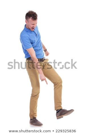 angry young casual man stepping on something Stock photo © feedough