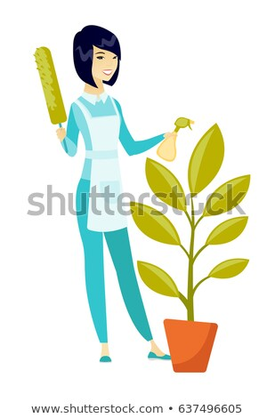 Asian housemaid watering the flower with spray. Stock photo © RAStudio