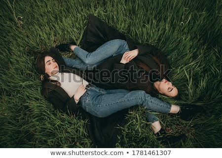 Romantic portraits of young brunette outdoors at spring. stock photo © lithian