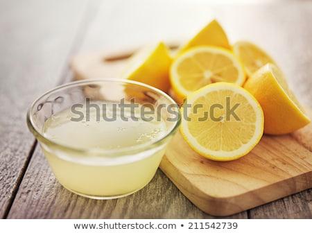 lemon juice and fresh lemons stock photo © digifoodstock