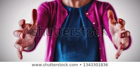 Középső rész lány tart láthatatlan tárgy fehér Stock fotó © wavebreak_media