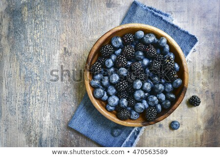 Fraîches bleuets bol sombre haut vue Photo stock © yelenayemchuk