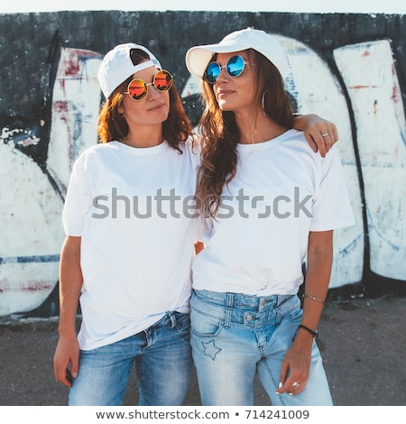 Young woman wearing a cap Stock photo © IS2