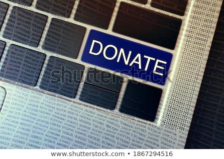 Keyboard with Blue Key - Charity. Stock photo © tashatuvango