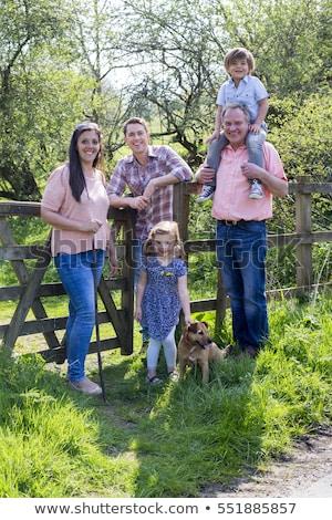 couple posing on farm gate Stock photo © IS2