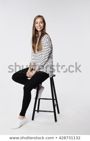 Mosolygó nő ül zsámoly néz kamera nagy mosoly Stock fotó © filipw