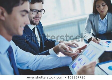 Businessman using touchscreen Stock photo © IS2