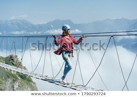 Woman walking over bridge Stock photo © IS2