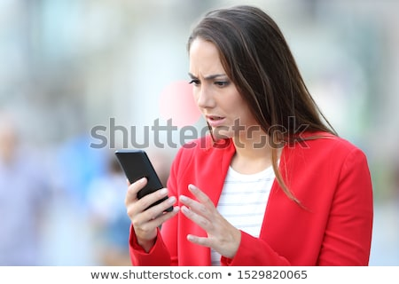 Woman receiving sad message on smart phone Stock photo © Kzenon