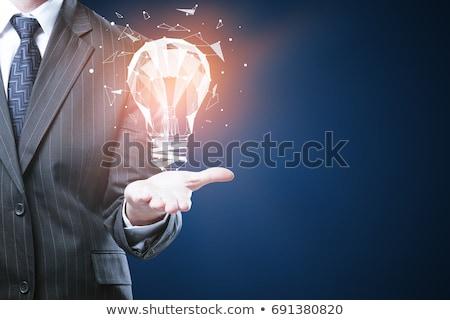 üzlet innováció ötletek üzletember keres akták Stock fotó © stokkete