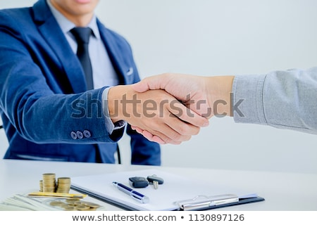 Businesswomen handshaking after deal agreement Stock photo © boggy