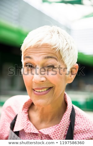 Portrait of an senior  woman who hints Stock photo © boggy
