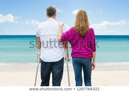 инвалидов человека Постоянный жена пляж вид сзади Сток-фото © AndreyPopov