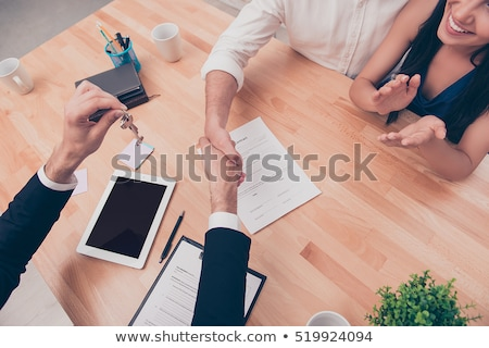 real estate agent giving house key to young couple stock photo © andreypopov