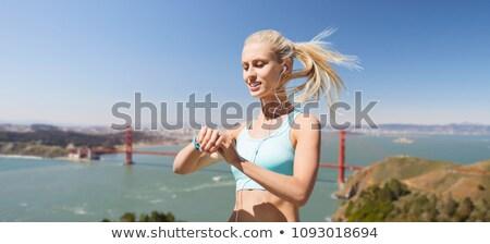 woman with fitness tracker over golden gate bridge Stock photo © dolgachov
